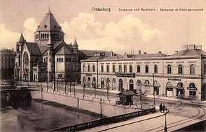 Chemins de fer de l'Est - An old railway station of the Compagnie des chemins de fer de l'Est in Strasbourg (right) from a 1900 postcard. The German text translates to Market Hall and Synagogue.