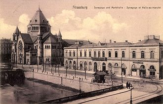 Chemins de fer de l'Est - An old railway station of the Compagnie des chemins de fer de l'Est in Strasbourg (right) from a 1900 postcard. The German text translates to Synagogue and Market Hall.