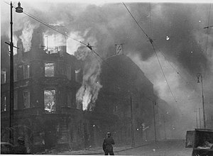 "A Survivor from Warsaw - Stroop Report original caption: ""Destruction of a housing block."" Photo from intersection of Zamenhofa and Wołyńska."