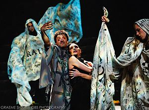 Synetic Theater - Paata Tsikurishvili as the Master and Irina Tsikurishvili as Margarita with Sarah Taurchini and Katherine Frattini as manuscript pages. From the 2010/2011 production of The Master and Margarita at the Lansburgh Theatre