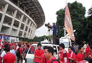Media of Indonesia - An Indonesian TV channel in Jakarta Stadium, reporting a football match.