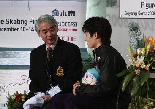 Takahiko Kozuka with Nobuo Sato kiss & cry 2008-2009 GPF