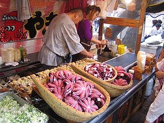 Giant Pacific octopus - Takoyaki stall in Nishi-Magome, Tokyo