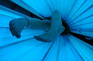A tanning bed in use.