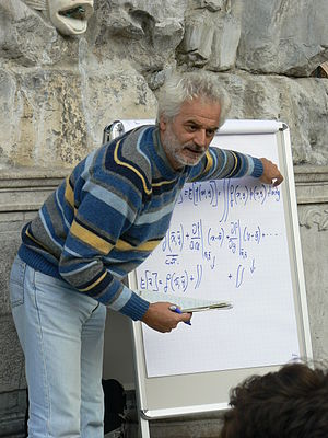Academic ranks in Italy - Professor teaching to university students in Trieste, Italy