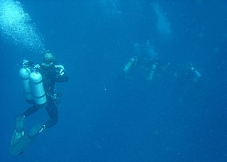 Decompression (diving) The reduction of ambient pressure on underwater divers after hyperbaric exposure and the elimination of dissolved gases from the divers tissues