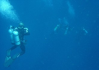 Technical divers at a midwater decompression stop