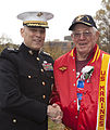 The Assistant Commandant of the Marine Corps, Gen. John M. Paxton, Jr., left, poses for a photo with a Marine veteran during an Honor Flight event at the Marine Corps War Memorial in Arlington, Va., Sept 131112-M-KS211-006.jpg