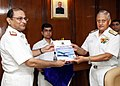 The Chief of Naval Staff, Admiral Nirmal Verma handing over the Operating Manual of the Naval Healthcare Information Management System (NHIMS) to the DGMS (Navy), Surgeon Vice Admiral A.C. Anand, in New Delhi.jpg