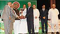 The Minister of State (Independent Charge) for Consumer Affairs, Food and Public Distribution, Professor K.V. Thomas presenting the Efficiency Award to the Sahakari Khand Udyog Mandal Ltd. P.O. Gandevi Via Bilimora.jpg