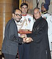 The President, Shri Pranab Mukherjee presenting the Padma Bhushan Award to Prof. Ashoke Sen, at an Investiture Ceremony, at Rashtrapati Bhavan, in New Delhi on April 05, 2013.jpg
