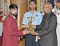 The President, Shri Ram Nath Kovind presenting the Arjuna Award, 2017 to Shri Satyawart Kadian for Wrestling, in a glittering ceremony, at Rashtrapati Bhavan, in New Delhi on August 29, 2017.jpg