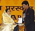 The President, Smt. Pratibha Devisingh Patil presenting the Award to Shri Madhur Bhandarkar for the Best Direction, at the 54th National Film Awards function, in New Delhi on September 02, 2008.jpg
