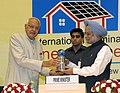 "The Prime Minister, Dr. Manmohan Singh being presented a memento by the Union Minister for New and Renewable Energy, Dr. Farooq Abdullah, at the ""International Seminar on Energy Access"", in New Delhi on October 09, 2012.jpg"