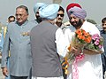 The Prime Minister, Dr. Manmohan Singh being welcomed by the Chief Minister of Punjab, Capt. Amarinder Singh at Halwara Air Force Station, Ludhiana, Punjab on September 27, 2006.jpg