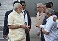 The Prime Minister, Shri Narendra Modi being received by the Governor of Gujarat, Shri O.P. Kohli and the Chief Minister of Gujarat, Shri Vijay Rupani, on his arrival, at Ahmedabad, Gujarat on September 13, 2017 (1).jpg