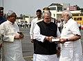 The Prime Minister, Shri Narendra Modi being welcomed by the Governor of Bihar, Shri Satya Pal Malik and the Chief Minister of Bihar, Shri Nitish Kumar, on his arrival, in Patna, Bihar on October 14, 2017 (1).jpg