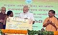 The Prime Minister, Shri Narendra Modi distributing the certificate to beneficiaries of the Pradhan Mantri Awas Yojana (Rural & Urban), at Shahanshahpur, Varanasi, Uttar Pradesh.jpg