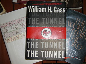 "William H. Gass - A paperback copy of William H. Gass' controversial novel ''The Tunnel'' on top of two of his collections of essays: ""Habitations of the Word"" and ""The World Within the Word"""