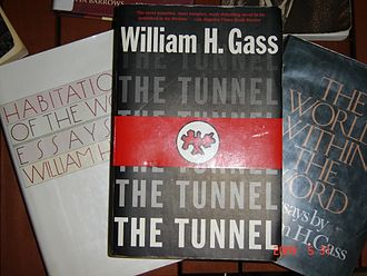 """William H. Gass - A paperback copy of William H. Gass' controversial novel ''The Tunnel'' on top of two of his collections of essays: """"Habitations of the Word"""" and """"The World Within the Word"""""""