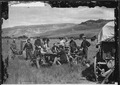 The U.S. Geological Survey in camp at Red Buttes. Figures are 1. F.V. Hayden, U.S. Geologist in Charge, 2. James Stevens - NARA - 516891.tif