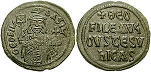 "Theophilos (emperor) - Follis of a new type, minted in large quantities in celebration of Theophilos' victories against the Arabs from ca. 835 on. On the obverse he is represented in triumphal attire, wearing the toupha, and on the reverse the traditional acclamation ""Theophilos Augustus, you conquer""."