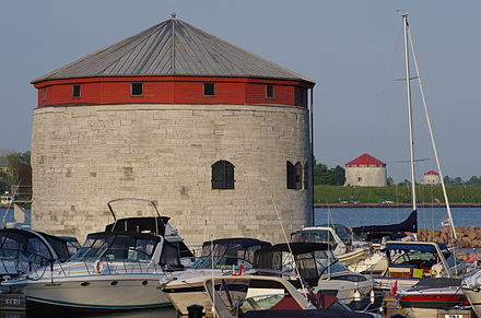 Line of defence: three Martello towers (Shoal Tower, Fort Frederick, Cathcart Tower). A fourth tower, Murney Tower, is southwest of this location Three Martellos in Kingston Ontario.jpg