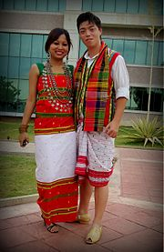 A man and a woman in traditional Tripuri dress