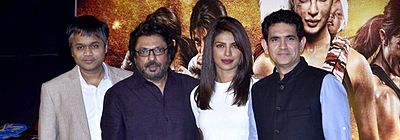 A photograph of Ajit Andhare, Sanjay Leela Bhansali, Priyanka Chopra and Omung Kumar looking forward, smiling and posing for the camera