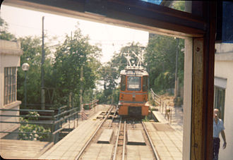 Trieste–Opicina tramway - The top of the cable section at Vetta Scorcola, showing the very closely spaced double track, haulage cables and a second-generation cable tractor.