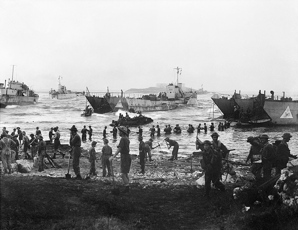 Troops from 51st Highland Division unloading stores from tank landing craft on the opening day of the Allied invasion of Sicily, 10 July 1943. A17916