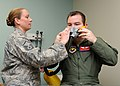 U.S. Air Force Master Sgt. Anna Nelson, left, the 97th Medical Operations Squadron superintendent, fits an aviator mask on Capt. Stephen Edstrom, a flight surgeon with the 97th Medical Operations Squadron 120106-F-BT319-907.jpg