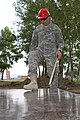 U.S. Army Staff Sgt. Matthew Zawel, with the 176th Engineer Company (Vertical), 96th Troop Command, Washington Army National Guard, measures a sheet of plywood during renovation work on the Erdmiin Oyun School 130725-M-DR618-037.jpg