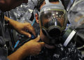 U.S. Navy Air Traffic Controller 3rd Class Benjamine Byers, assigned to amphibious assault ship USS Makin Island (LHD 8), undergoes respirator mask testing in the ship's hangar bay Jan. 13, 2011, in San Diego 110113-N-ZS997-006.jpg