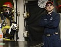 U.S. Navy Aviation Structural Mechanic 2nd Class Joshua Axline, left, serves as the nozzleman on a firefighting hose team as Hull Maintenance Technician 2nd Class Matthew Chaney, a damage control training team 130816-N-TW634-022.jpg