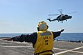 U.S. Navy Boatswain's Mate 1st Class James Small directs a Royal Malaysian Navy Super Lynx helicopter as it does touch and go training June 18, 2013, during Cooperation Afloat Readiness and Training (CARAT) 2013 130618-N-PD773-044.jpg