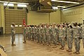 U.S. Soldiers with Detatchment 1, 150th Engineer Company, Delaware Army National Guard, stand in formation during their deployment ceremony at Wilmington, Del., Aug. 11, 2013 130811-Z-GL773-028.jpg
