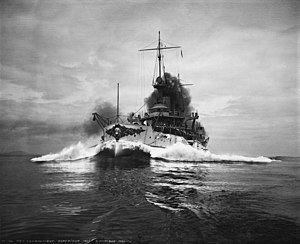 USS Connecticut (BB-18) - Connecticut on her speed trials in 1906 or 1907. The boat taking this photo is about to be swamped by the bow wave emanating from the battleship.