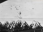 USS Enterprise (CV-6) is hit by kamikaze - seen from USS Essex (CV-9) on 14 May 1945.jpg