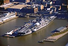An aerial view of the USS Intrepid docked at pier 86.