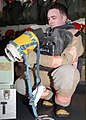 US Navy 021112-N-6817C-001 Damage Controlman inspects the Naval Firefighting Thermal Imaging (NFTI).jpg