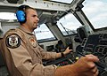 US Navy 040614-N-4374S-008 Lt. Ryan Meeuf, Landing Signal Officer (LSO), mans the LSO console during flight quarters.jpg