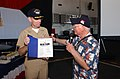 US Navy 040811-N-4776G-070 USS Ronald Reagan (CVN 76) Commanding Officer, Capt. James Symonds, is presented with a World War II (WWII) book autographed by Pearl Harbor survivors.jpg