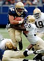 US Navy 041016-N-9693M-004 U.S. Naval Academy Midshipman 1st Class Kyle Eckel is tackled by Notre Dame line backer Brandon Hoyte at Giants Stadium in Rutherford, N.J.jpg