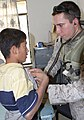 US Navy 041026-M-1250B-002 Hospital Corpsmen 3rd Class Nathan Silvers, assigned to the 24th Marine Expeditionary Unit (MEU), examines the lungs of an Iraqi student.jpg