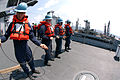 US Navy 050210-N-9860Y-135 Seaman Kristian B. Fabian of Signal Hill, Calif., along with members of the Deck Department aboard USS Blue Ridge (LCC 19), heave on the boom line during a replenishment at sea.jpg
