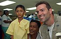 US Navy 050212-N-6504N-007 New York Giants quarterback Kurt Warner poses for a photo with an Indonesian boy and a member of his family aboard the Military Sealift Command (MSC) hospital ship USNS Mercy (T-AH 19).jpg