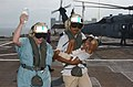 US Navy 050222-N-6665R-038 A nurse from Project Hope carries an IV bag while an Indonesian man carries his boy from a MH-60S Seahawk helicopter after arriving aboard the Military Sealift Command (MSC) hospital ship USNS Mercy (.jpg