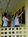 US Navy 050827-N-5914D-003 Sailors assigned to the amphibious assault ship USS Boxer (LHD 4), paint a classroom at Assumption Catholic School during a community outreach project in Majuro, Marshall Islands.jpg