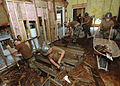 US Navy 050912-N-4374S-013 U.S. Navy Seabees, assigned to Naval Mobile Construction Battalion One Three Three (NMCB-133), tear through a plywood floor as they take part in restoring Hope Haven.jpg